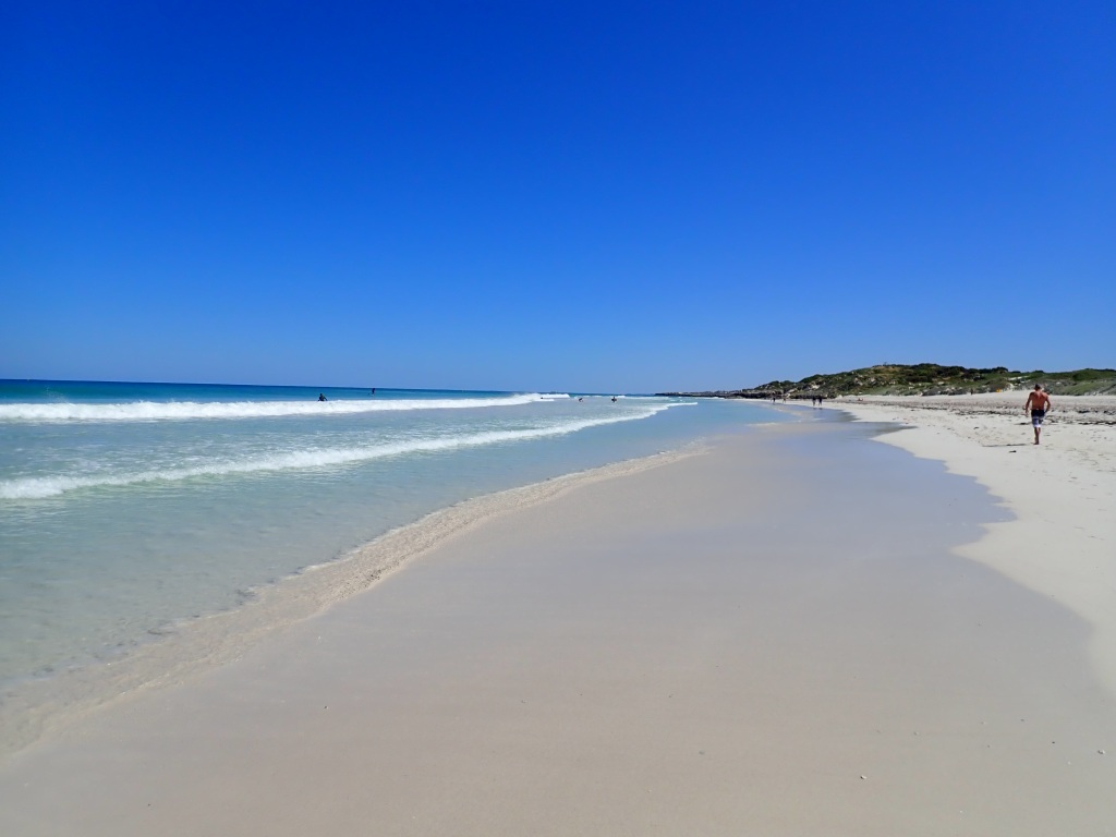 Scenic calm beach with white sand.