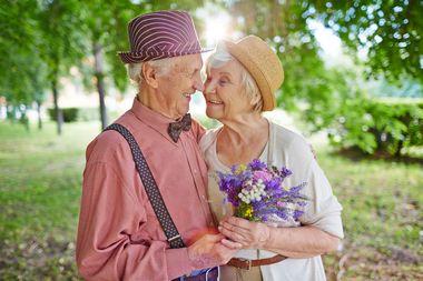 Elderly couple embracing.