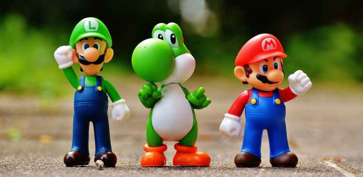 Funny image of two Mario characters and a green dragon.