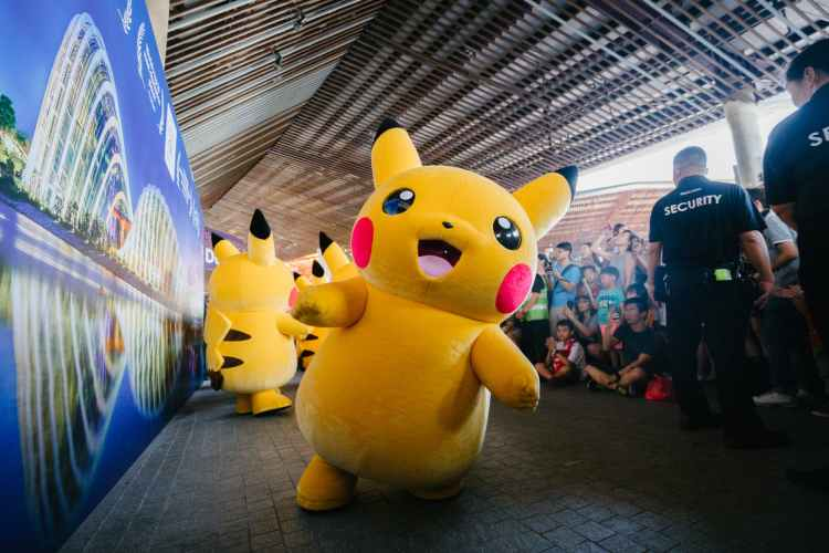 Large yellow Pokemon character in a parade.